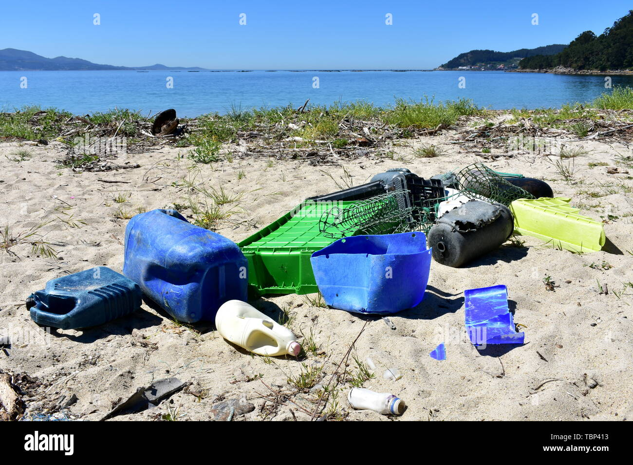 Dirty beach with plastic pollution. Galicia, Spain. - Stock Image