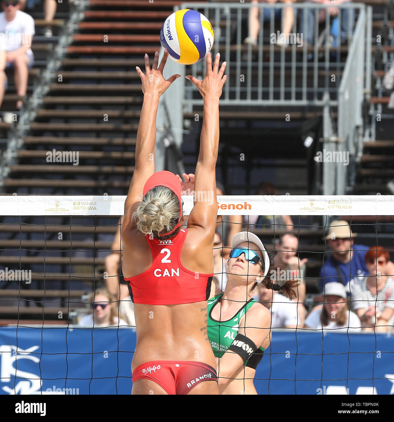 Ostrava, Czech Republic. 01st June, 2019. L-R Brandie Wilkerson (Canada) and Lena Plesiutschnig (Austria) in action during the four-star J&T Banka Ostrava Beach Open 2019, part of the FIVB Beach Volleyball World Tour, in Ostrava, Czech Republic, on July 1, 2019. Credit: Petr Sznapka/CTK Photo/Alamy Live News Stock Photo