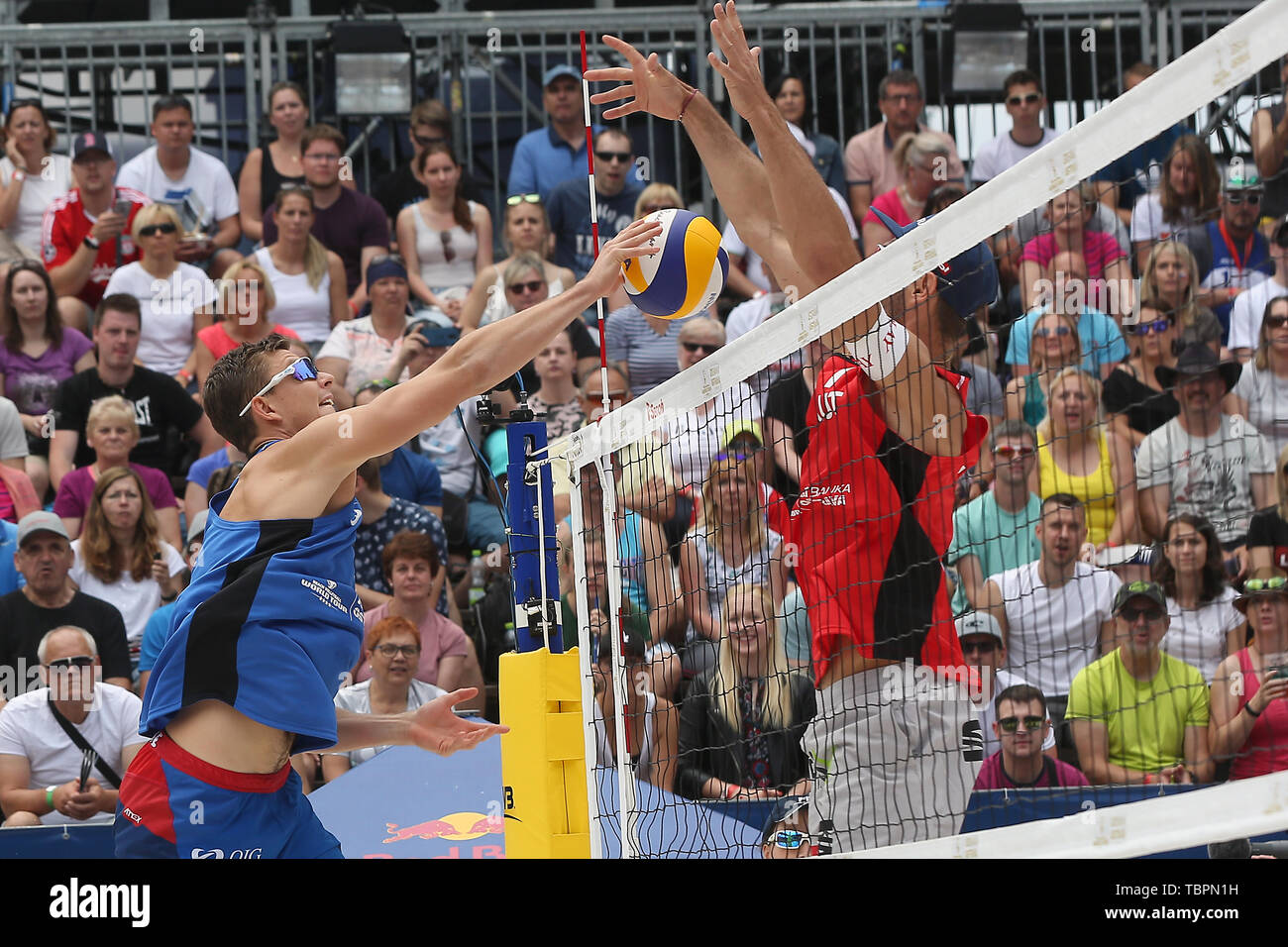 Ostrava, Czech Republic. 01st June, 2019. L-R David Schweiner (Czech) and Martin Ermacora (Austria) in action during the four-star J&T Banka Ostrava Beach Open 2019, part of the FIVB Beach Volleyball World Tour, in Ostrava, Czech Republic, on July 1, 2019. Credit: Petr Sznapka/CTK Photo/Alamy Live News Stock Photo