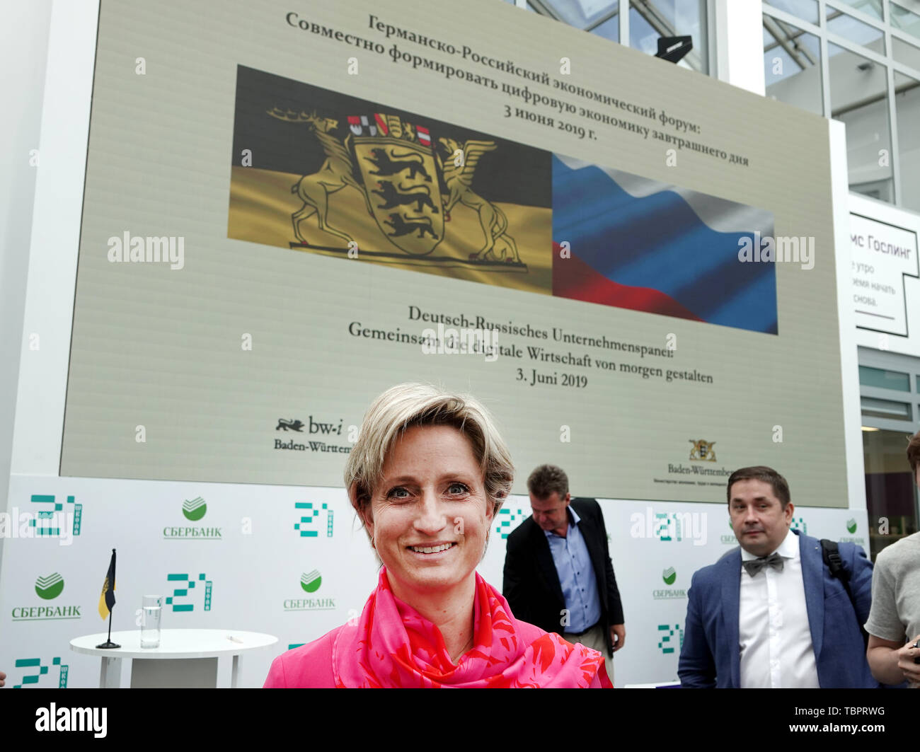 03 June 2019, Russia, Moskau: Nicole Hoffmeister-Kraut (CDU), Baden-Württemberg's Minister of Economic Affairs, starts her trip to Russia with the logo for a German-Russian company panel at School 21, a school for IT programmers at the Russian Sberbank. Photo: Ulf Mauder/dpa - Stock Image