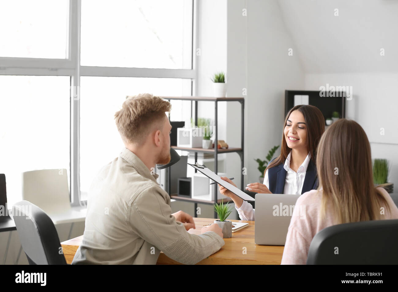 Young couple in office of real estate agent Stock Photo