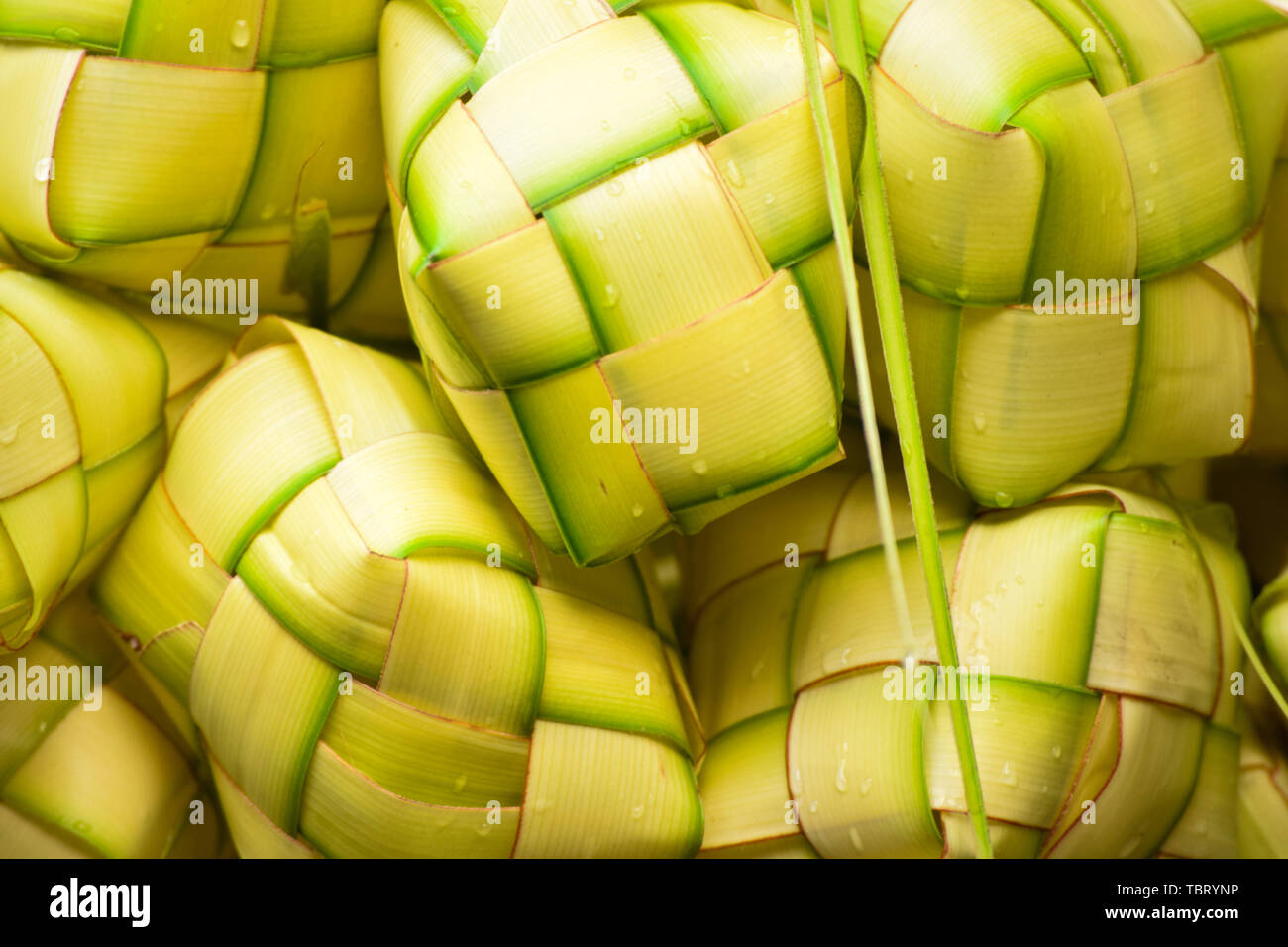 Ketupat 'asian rice dumpling'. Ketupat is a natural rice casing made from young coconut leaves for cooking rice during eid Mubarak Eid ul Fitr - Stock Image