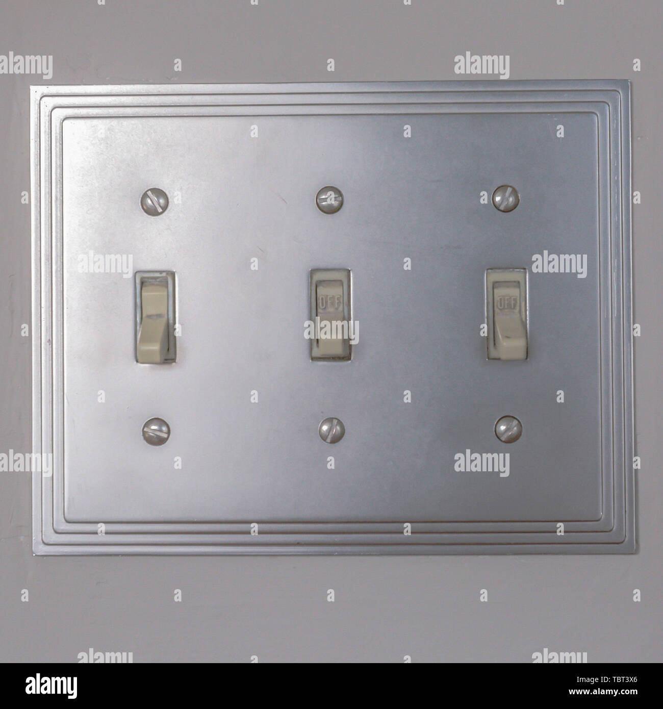 Square Close up view of vertical flip toggle light switches in off mode - Stock Image
