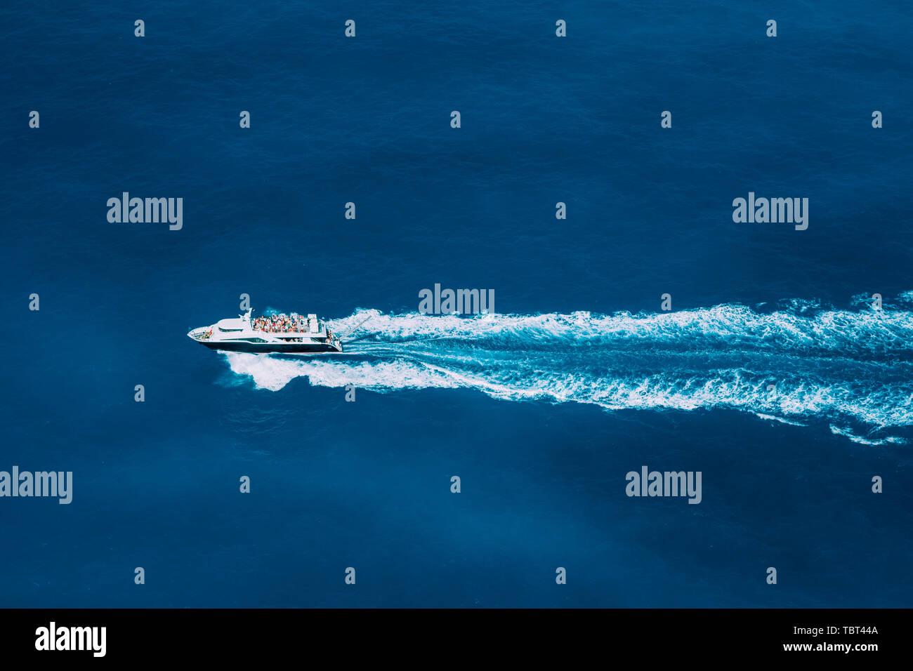 Tourist boat in full speed in open sea, Greece Stock Photo