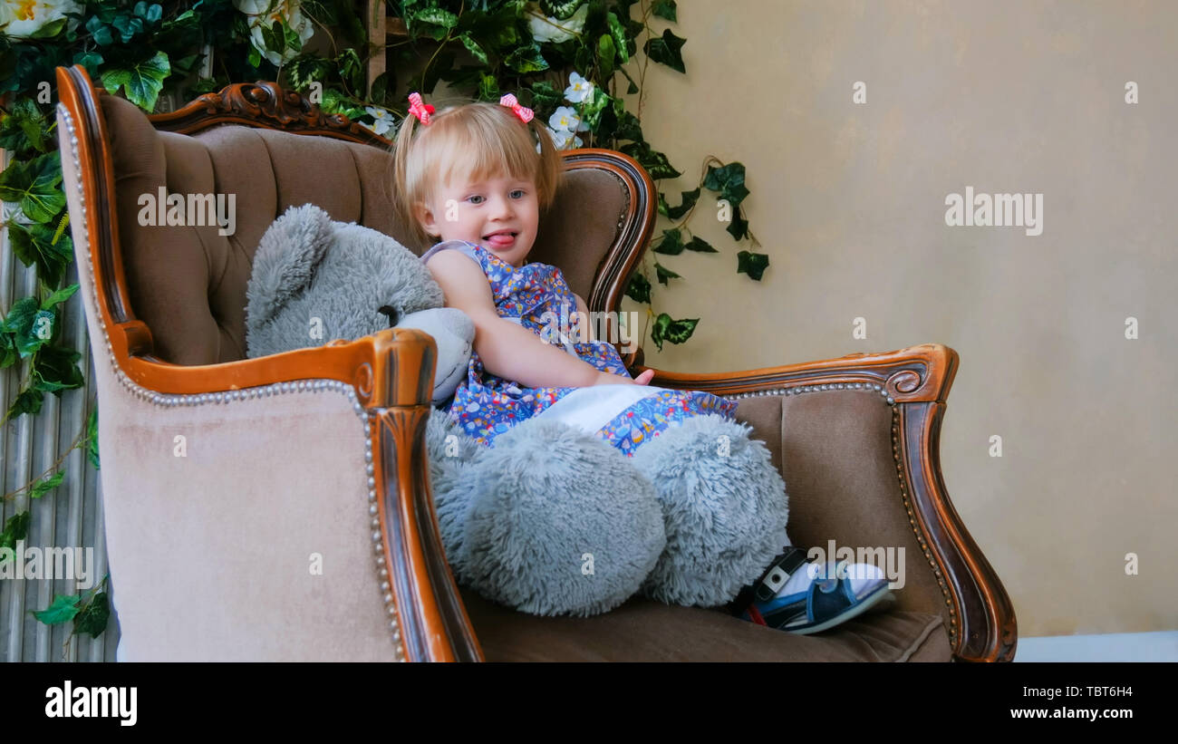 Portrait of funny little girl with bear doll at home Stock Photo