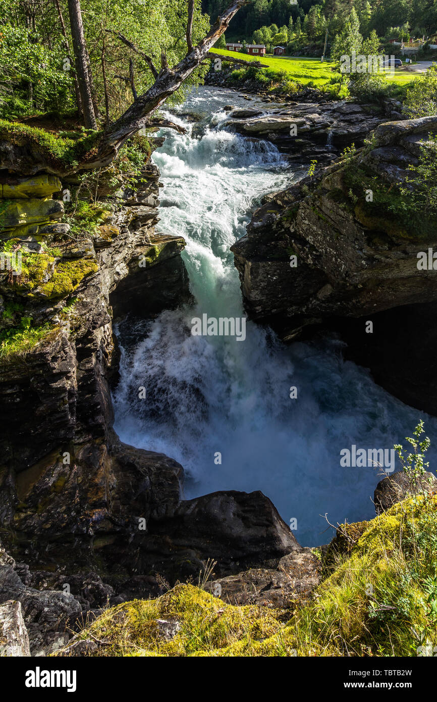 Gudbrandsjuvet waterfall forming a small rainbow, Sunnmore, More og Romsdal, Norway - Stock Image