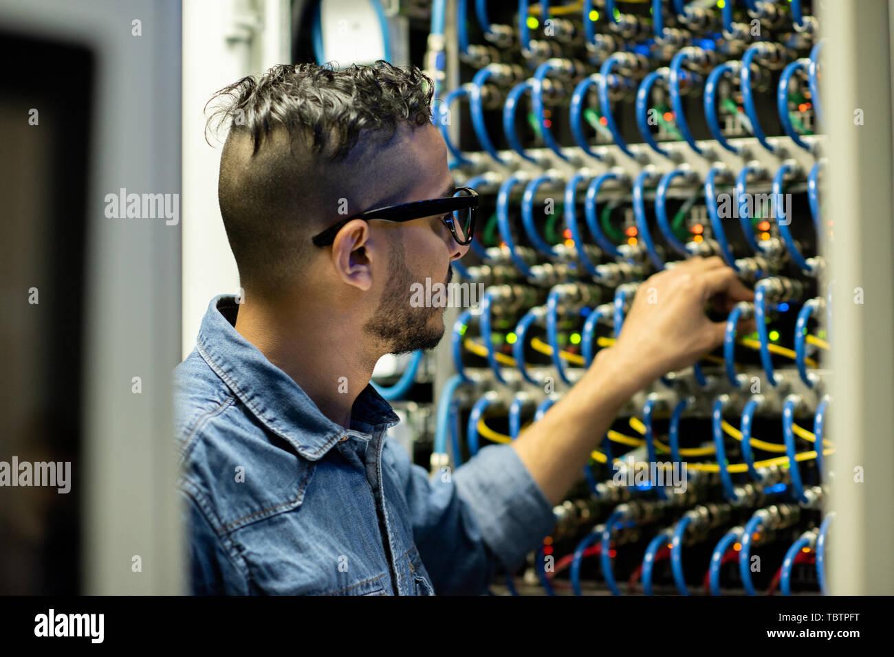 Mainframe engineer analyzing system of database storage - Stock Image
