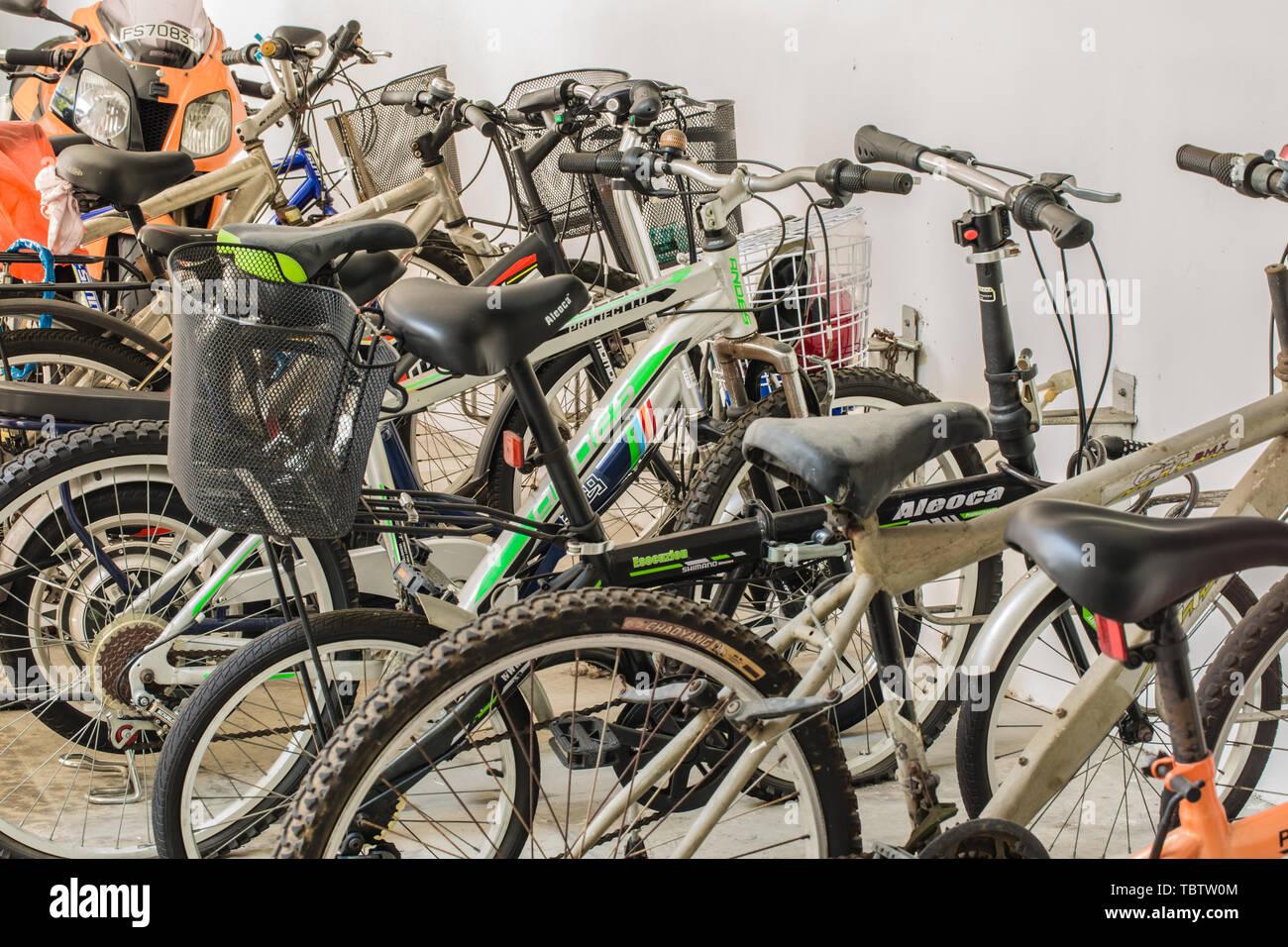 SINGAPORE-JUN 17 2017:bikes in basement car park - Stock Image