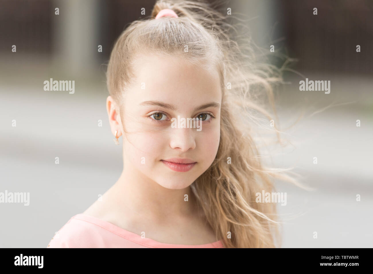 Organic skincare is like second nature. Adorable small girl with healthy young face skin, skincare. Beauty look of little skincare model. Childrens skincare products and cosmetics. - Stock Image