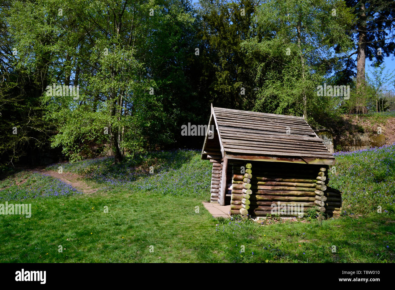 Summer House among the bluebells at Wakehurst Gardens, East Sussex, UK - Stock Image