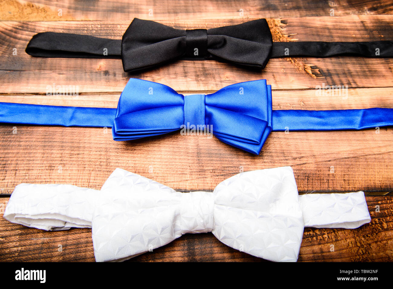 Esthete detail. Fix bow tie. Groom wedding. Textile fabric bow close up. Modern formal style. Menswear clothes. Perfect outfit. Tying bow tie. Wedding accessories. Fashion accessory. - Stock Image
