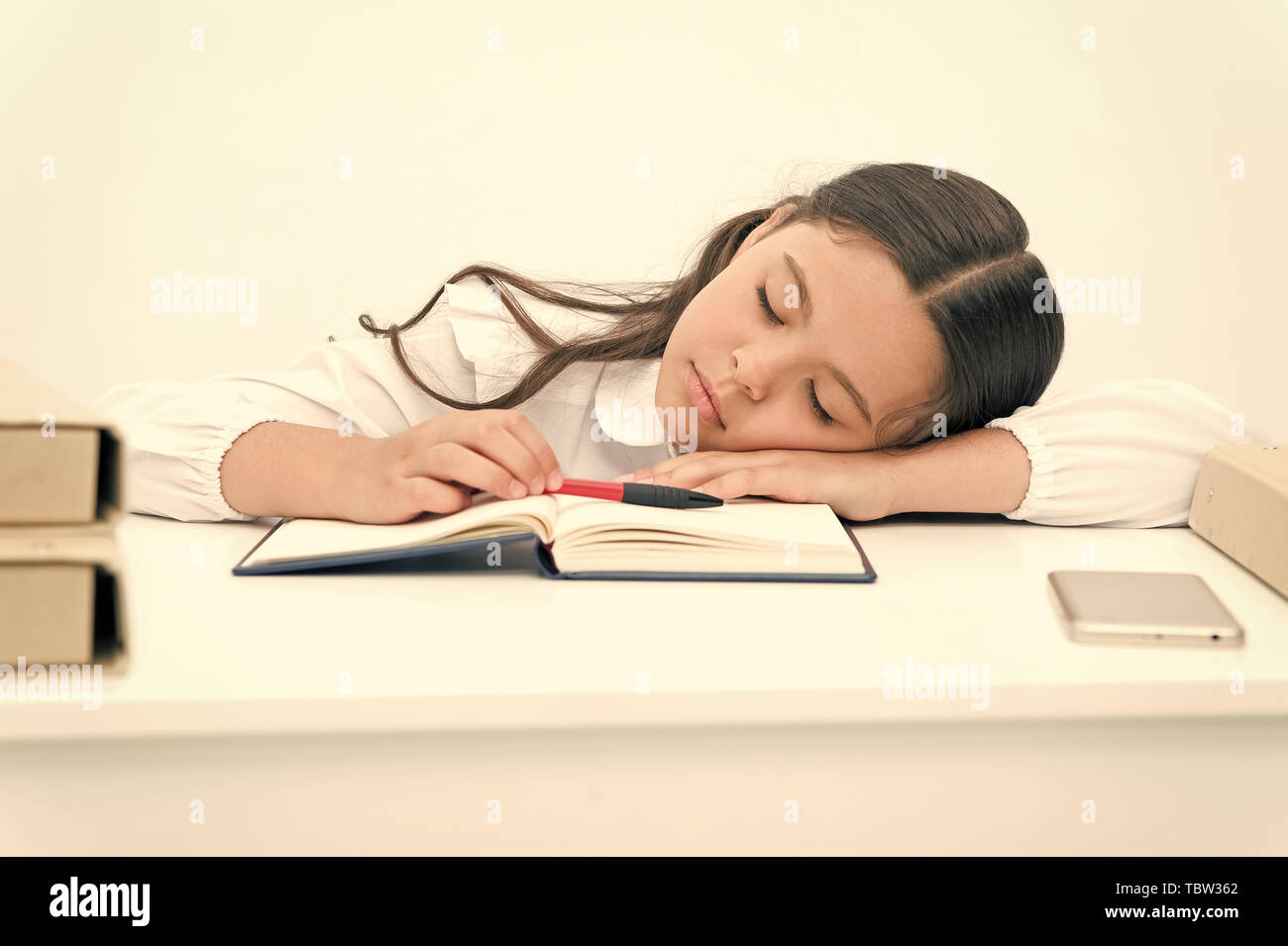 Nap concept. Tired schoolgirl have nap. Little girl taking nap at desk. It is a nap time. - Stock Image
