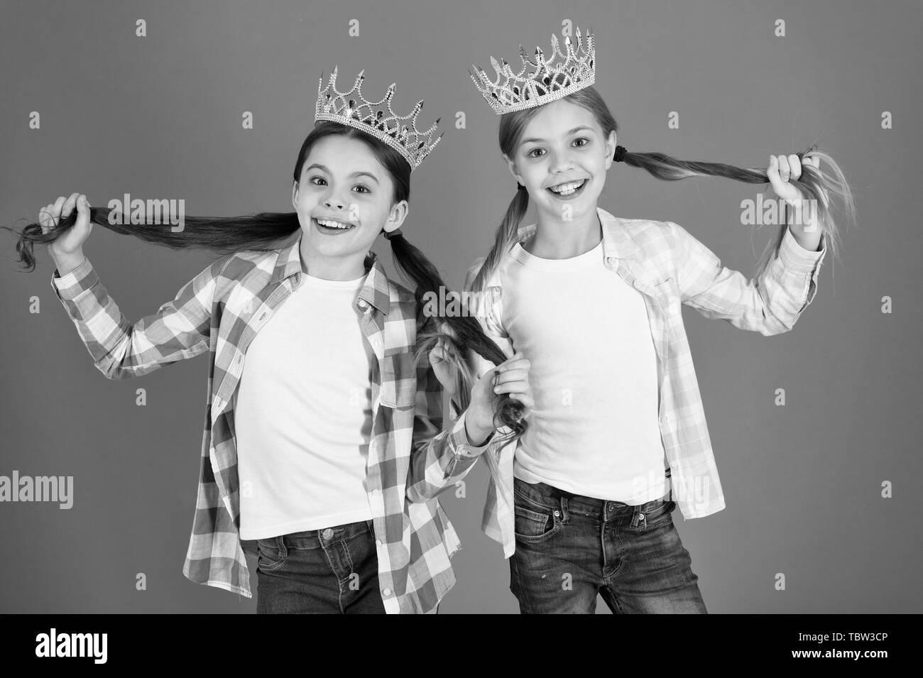 We deserve only best. Girls wear crowns. Spoiled children concept. Egocentric princess. Kids wear golden crowns symbol princess. Every girl dreaming become princess. Little princess. Happy childhood. - Stock Image
