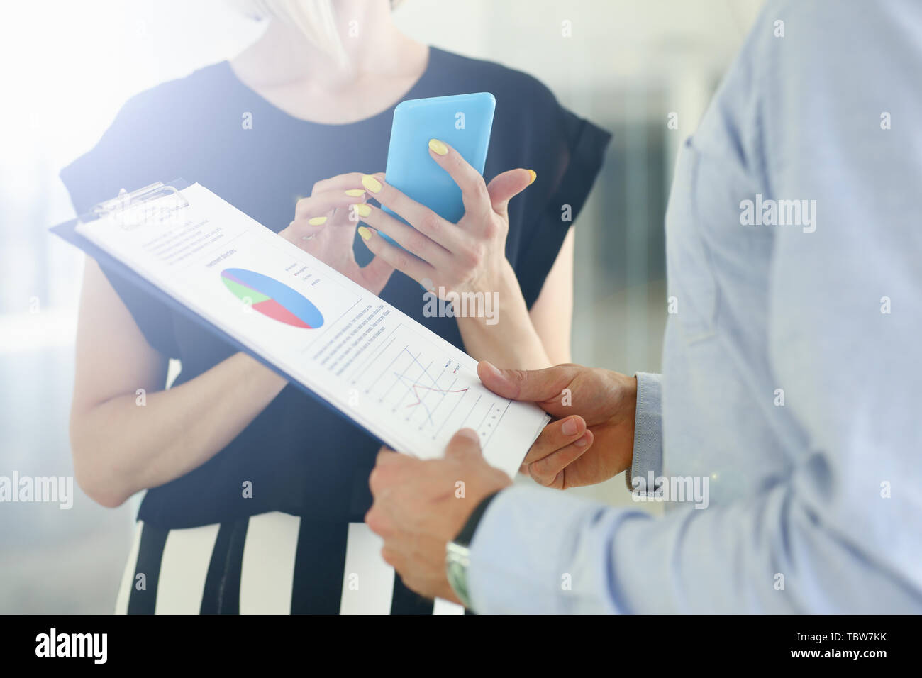Business people discussing company finances - Stock Image
