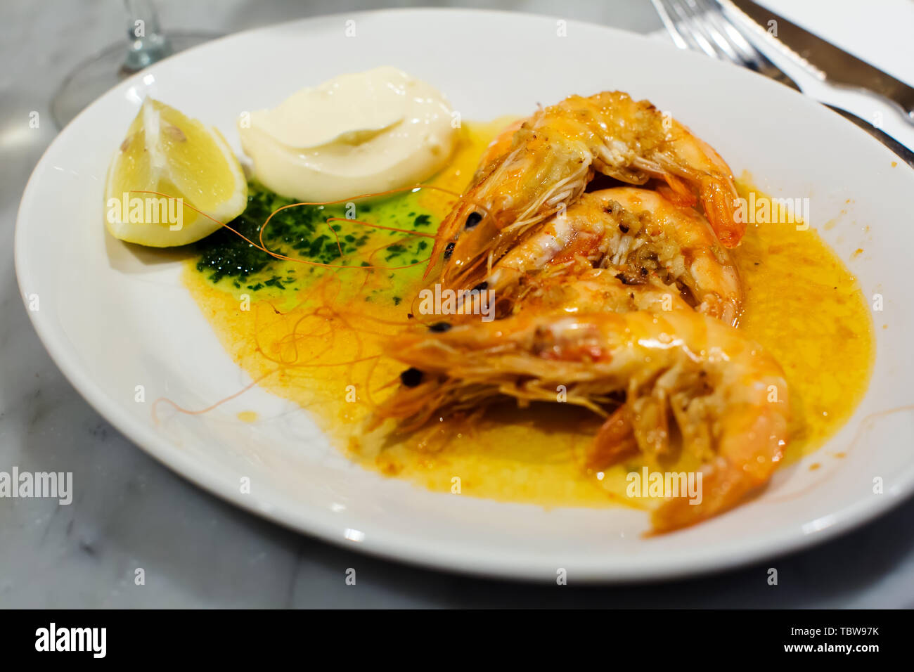 ready to eat served in the restaurant cooked prawns with souse - Stock Image