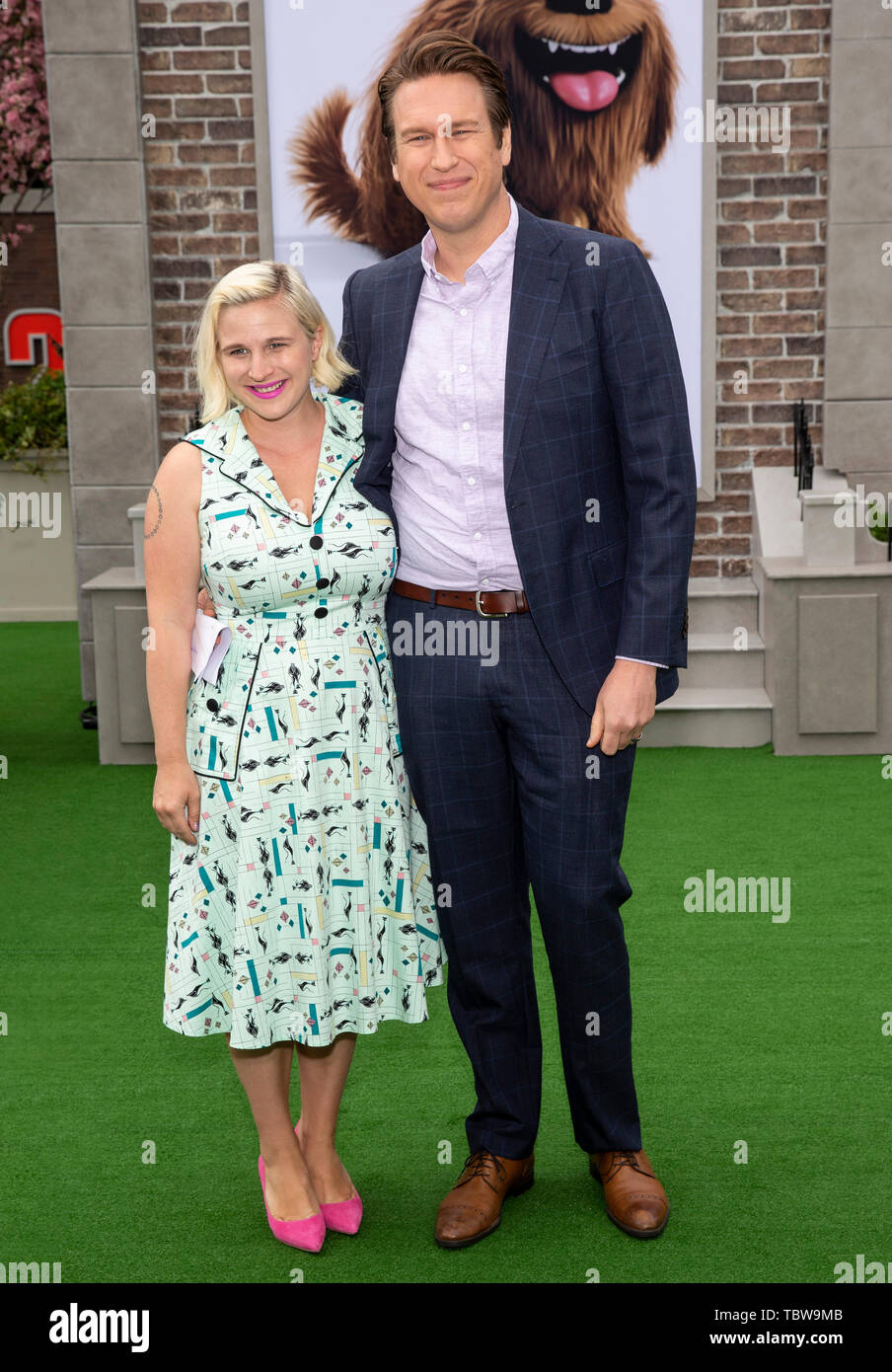 Los Angeles, CA - June 02, 2019: Valerie Chaney and Pete Holmes attend the Premiere Of Universal Pictures' 'The Secret Life Of Pets 2' held at Regency - Stock Image