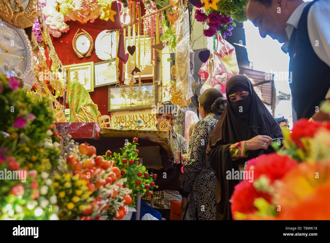 d3ad5449fb A Kashmiri Muslim woman seen shopping ahead of Eid-ul-Fitr festival which  marks