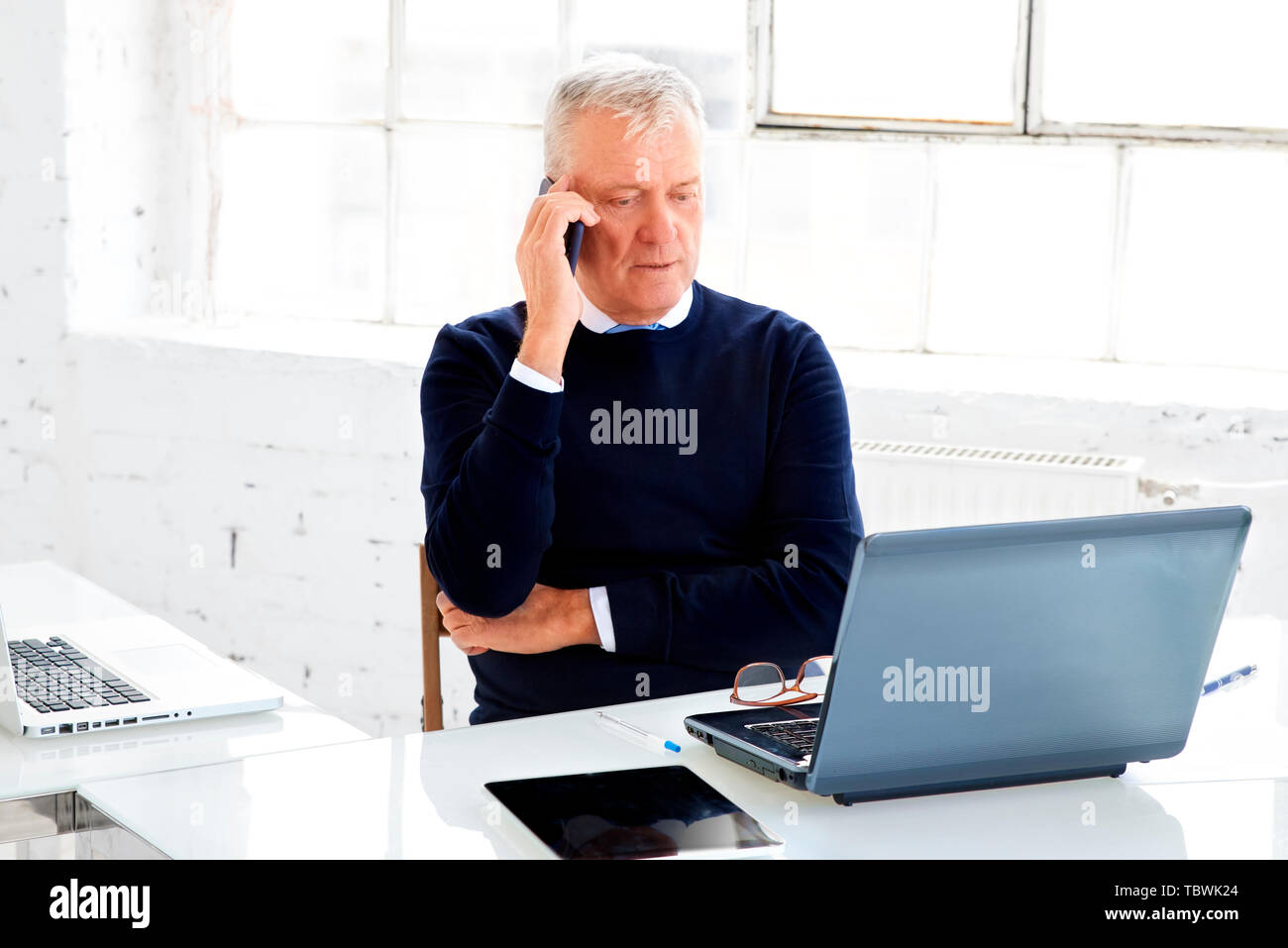 A Man On The Phone Behind His Desk Stock Photos A Man On