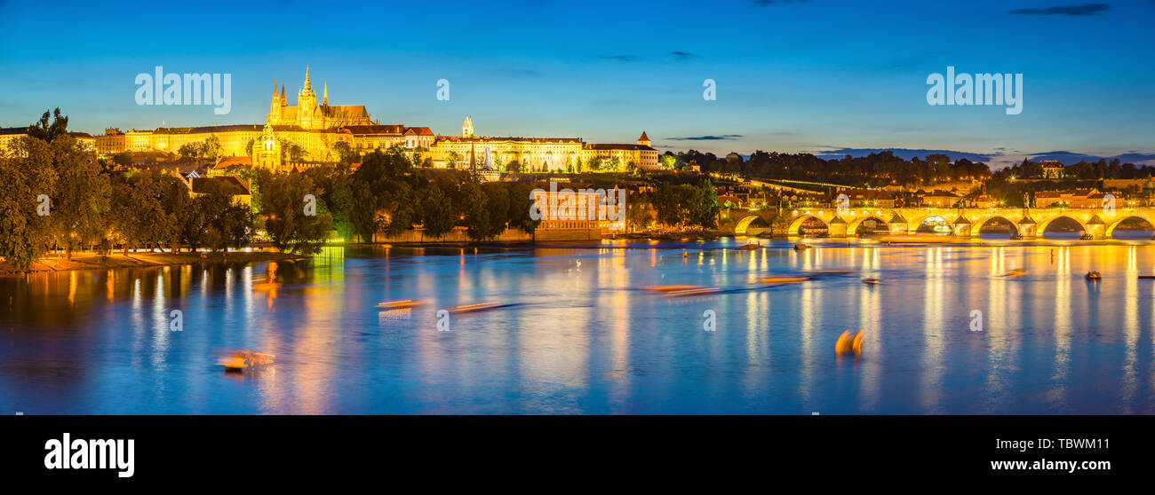 Night on the River Vltava with Prague Castle in the distance. Czech Republic Stock Photo