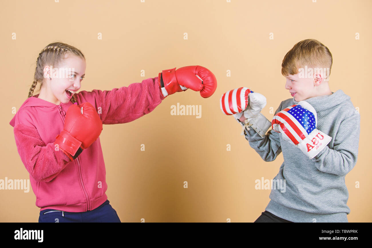 workout of small girl and boy boxer in sportswear. Happy children in boxing gloves. Fitness diet. punching knockout. Childhood activity. Sport success. Friendship fight. Work hard play hard. - Stock Image