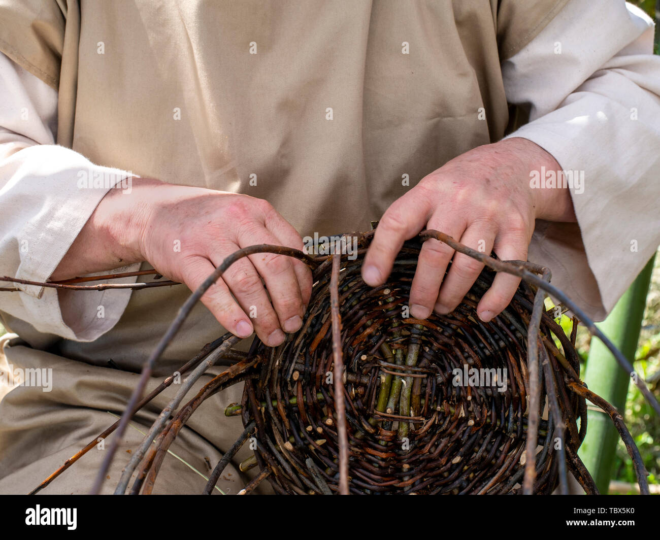 Basket weaver detail. Demonstration of ancient techniques, crafts. - Stock Image