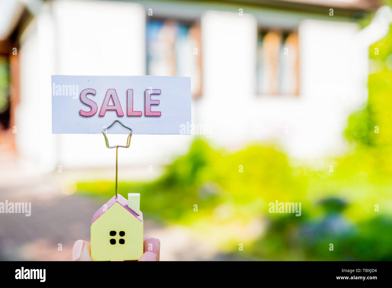 Small model of house and sale board. saving money for a residential and retire concepts. Real estate,Saving and buying home mortgage and loan - Stock Image
