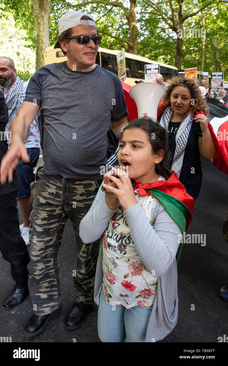 London, UK. 2nd June 2019. Thousands attended the pro Palestinian Annual Al-Quds Day March organised by the Islamic Human Rights Commission. A young girl holds a megaphone radio mic and chants free free Palestine. Credit: Stephen Bell/Alamy. - Stock Image