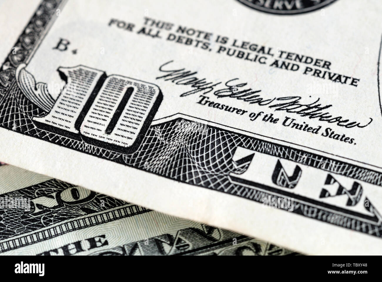 Fragment of a ten dollar bill closeup. Shallow depth of field Stock Photo