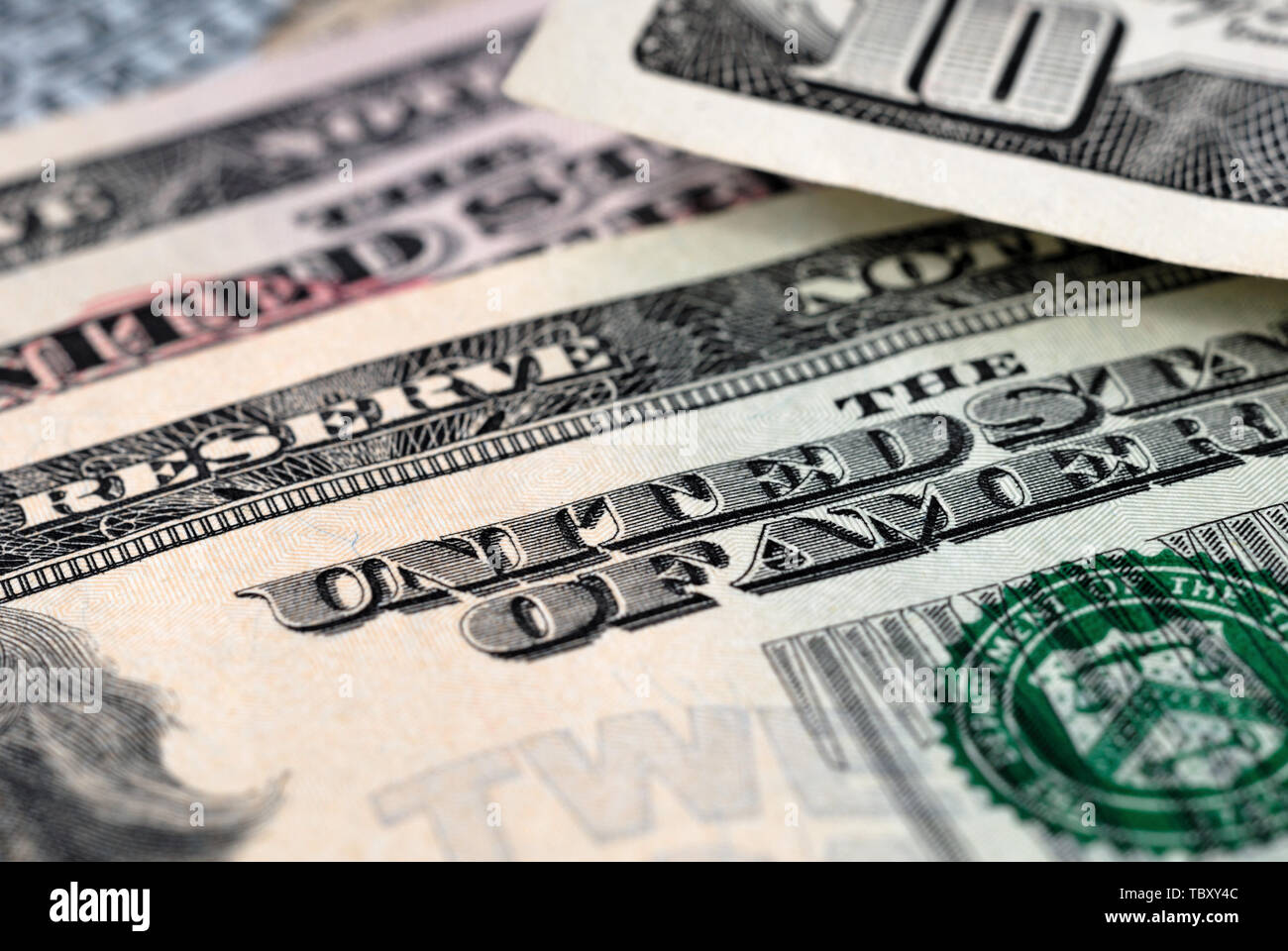 Dollar bills of different value on the table closeup. Shallow depth of field - Stock Image