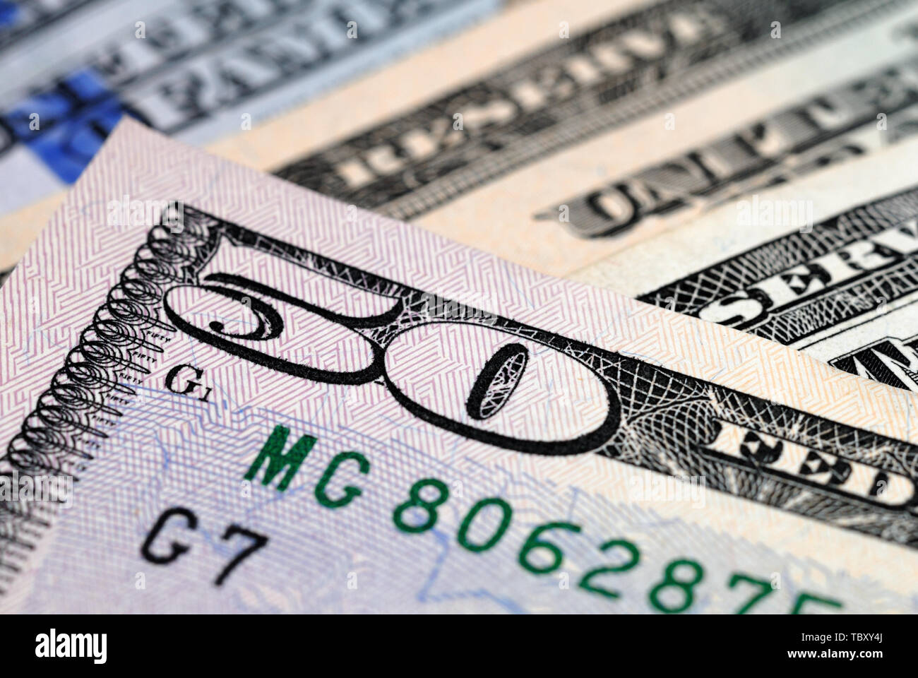 Fragment of a fifty dollar bill closeup. Shallow depth of field - Stock Image
