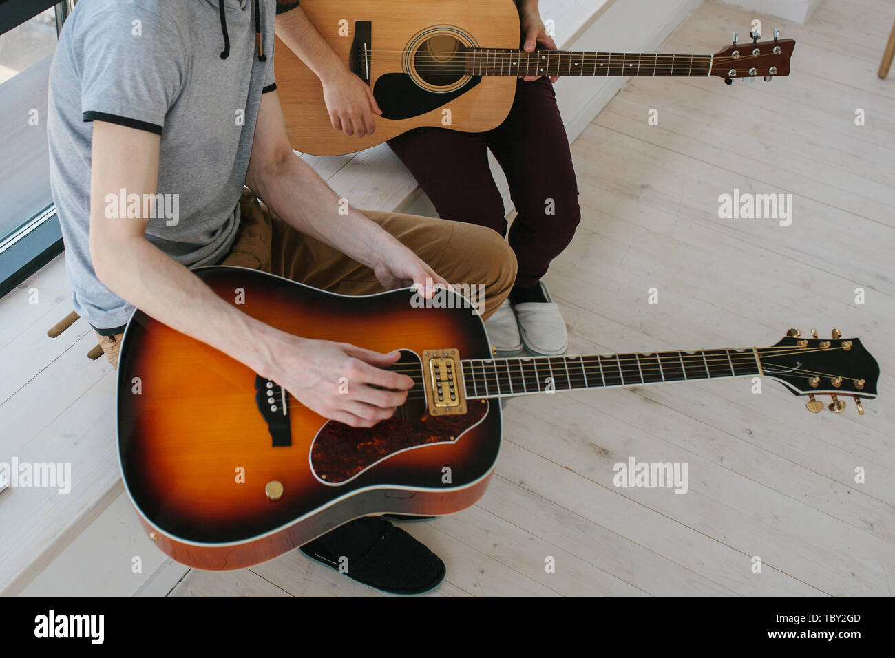 Learning to play the guitar. Extracurricular activities or tutoring or hobbies or creative activities. - Stock Image