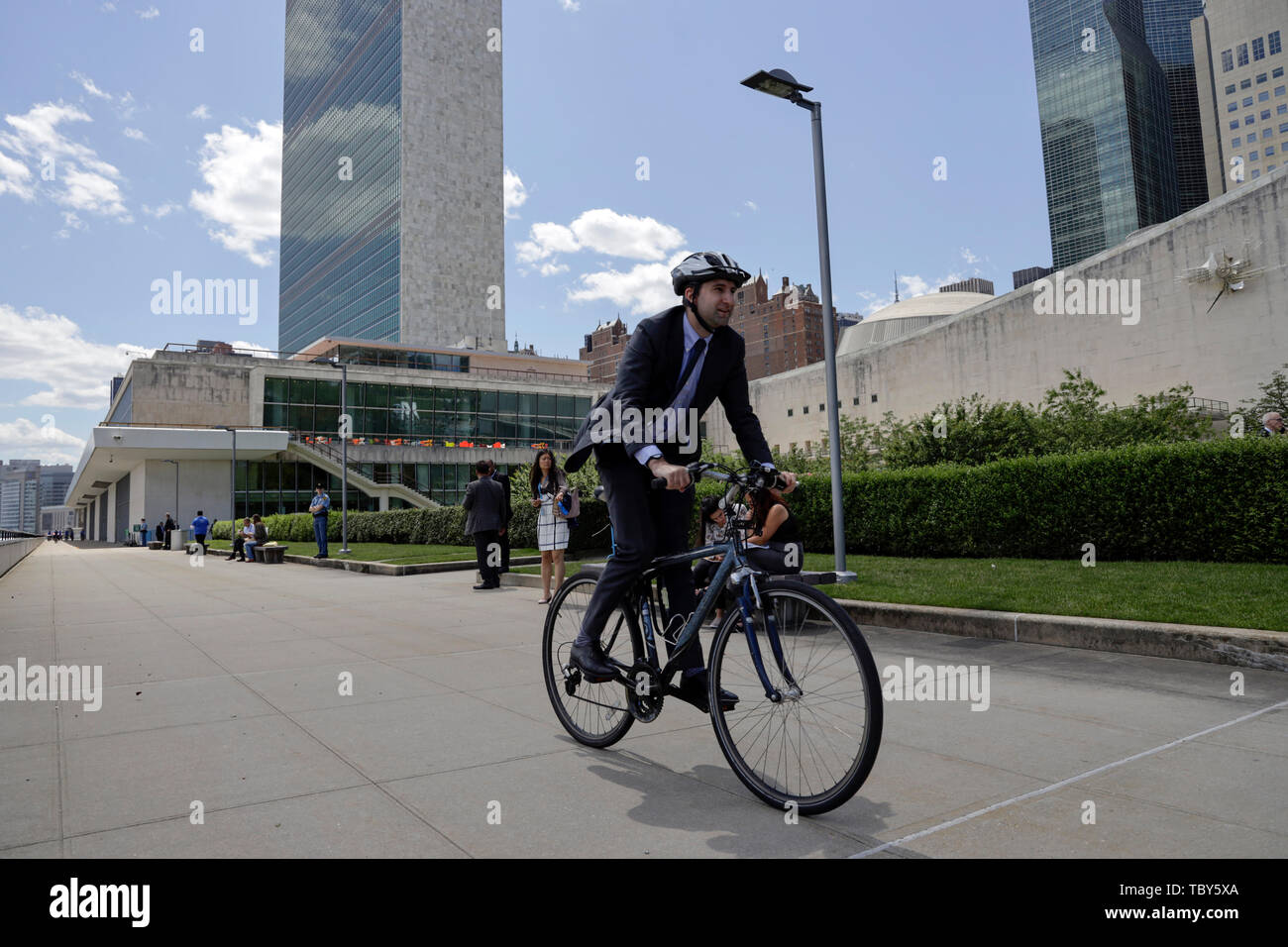United Nations. 3rd June, 2019. A man rides his bicycle during an event to commemorate the first World Bike Day at the UN headquarters in New York, June 3, 2019. The United Nations on Monday commemorated World Bicycle Day to acknowledge the uniqueness, longevity and versatility of bicycles. Credit: Li Muzi/Xinhua/Alamy Live News - Stock Image