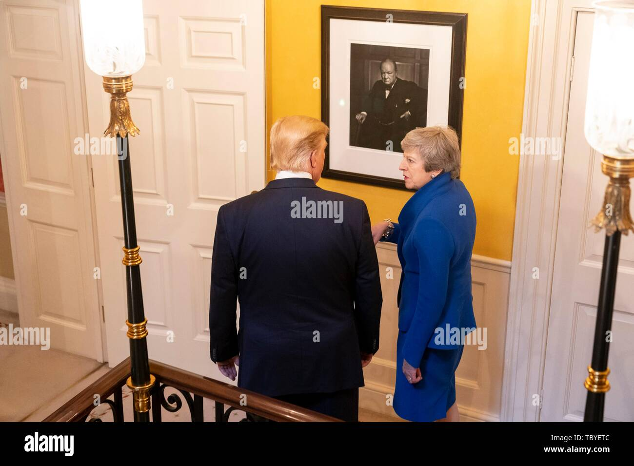 London, UK. 04th June, 2019. U.S President Donald Trump and outgoing British Prime Minister Theresa May walk past a portrait of former British Prime Minister Winston Churchill at No. 10 Downing Street June 4, 2019 in London, England. Credit: Planetpix/Alamy Live News - Stock Image