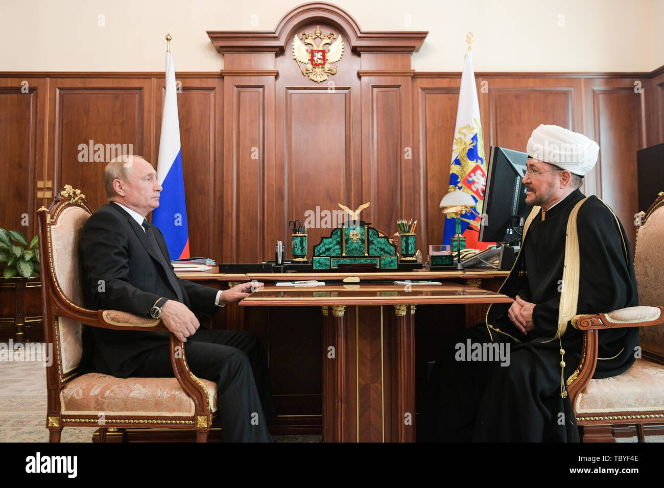 Moscow, Russia. 04th June, 2019. MOSCOW, RUSSIA - JUNE 4, 2019: Russia's President Vladimir Putin (L) meets with Ravil Gainutdin, chairman of the Russian Council of Muftis, at the Moscow Kremlin. Alexei Druzhinin/Russian Presidential Press and Information Office/TASS Credit: ITAR-TASS News Agency/Alamy Live News - Stock Image