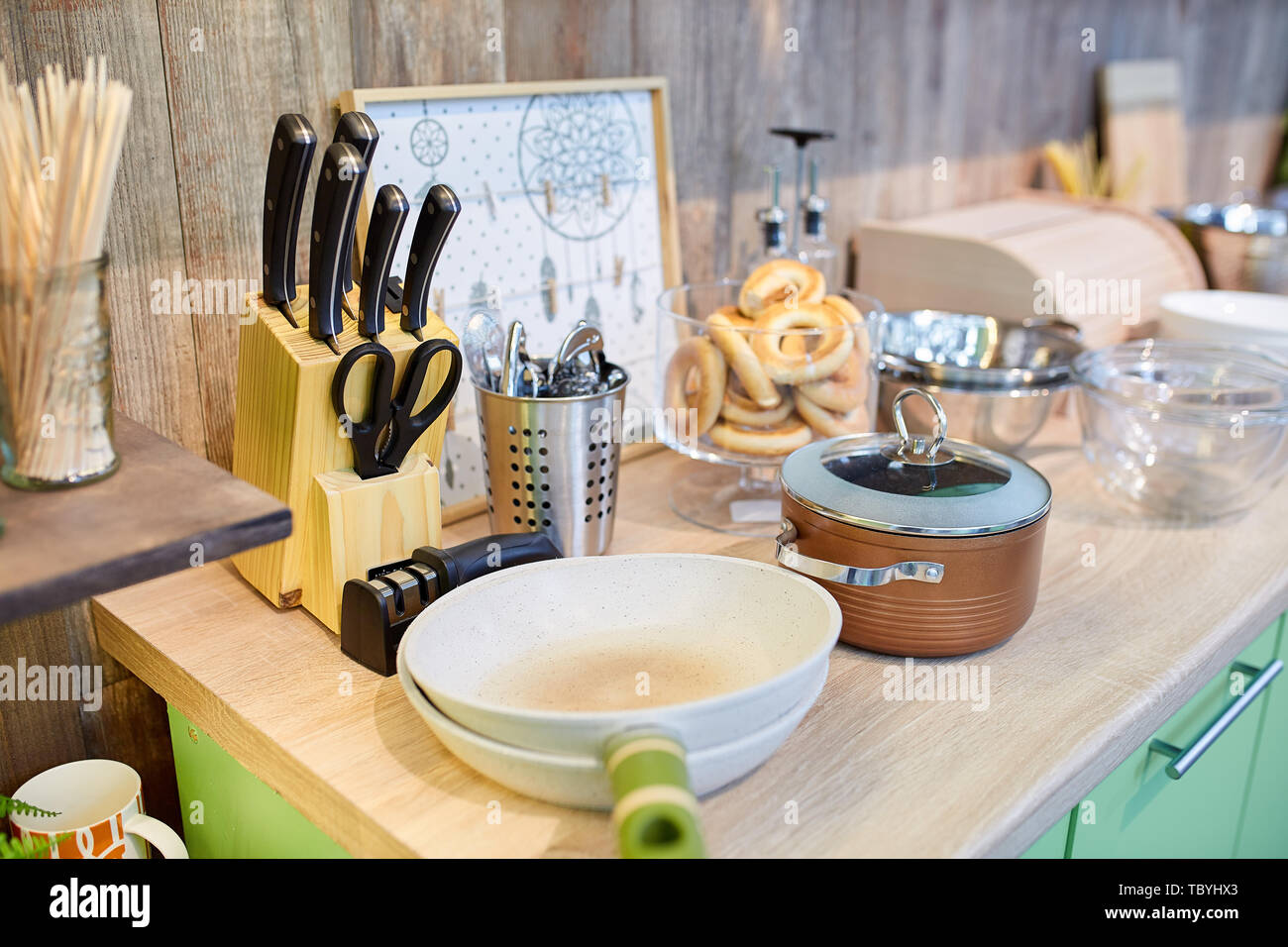 Kitchen utensils on the table. The hearth concept. - Stock Image