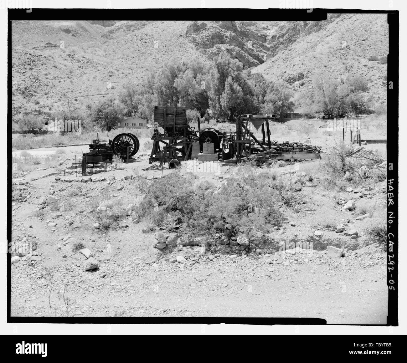 NORTH ELEVATION OF GOLD HILL MILL, LOOKING SOUTH, SHOWING RELATIONSHIP TO ROADWAY IN FOREGROUND.  Gold Hill Mill, Warm Spring Canyon Road, Death Valley Junction, Inyo County, CA - Stock Image