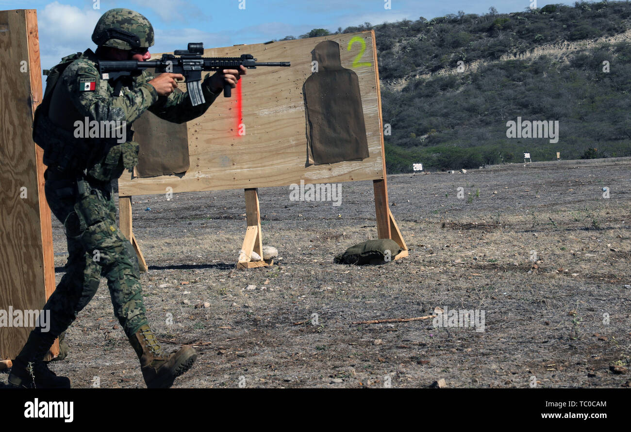 A Marine from the Mexican Marines runs through the live fire event during weapons training, Tradewinds 2019. In its 35th year, 22 nations have participated in the annual Tradewinds exercise to promote regional security as well as humanitarian assistance and disaster relief. (U.S. Army photo by Sgt. Leia D. Tascarini) - Stock Image