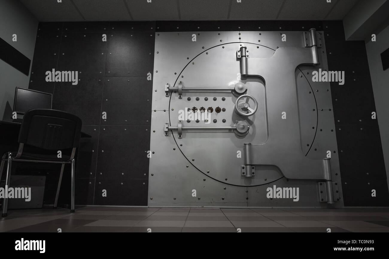 Closed steel bank vault door, close-up. Bank vault. Safe storage of valuables - Stock Image