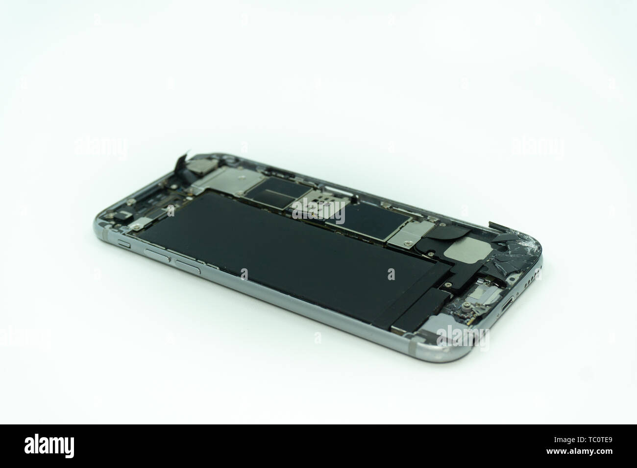 Photo of a mobile phone with broken display. Isolated on white with copy space - Stock Image
