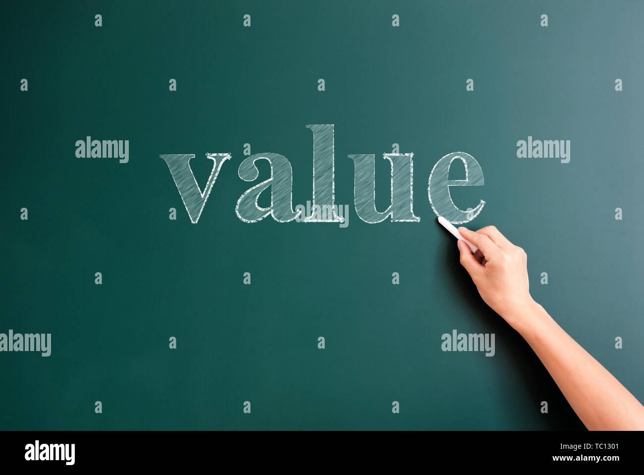 value written on blackboard - Stock Image