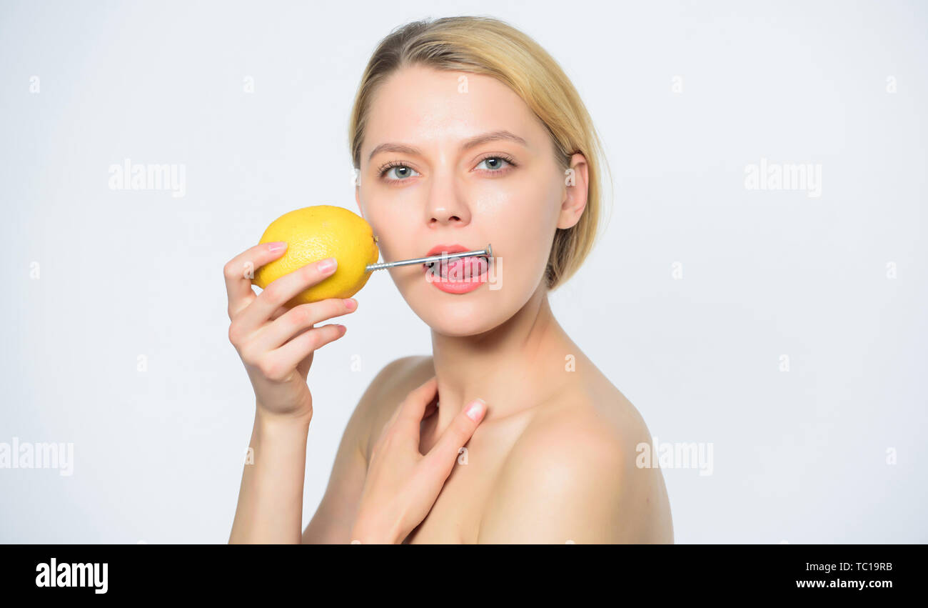 Energy recharge. Girl drink fresh juice lemon. Healthy lifestyle concept. Energy drink. Lemon with hobnail natural battery. Healthy lifestyle. Woman hobnail mouth. Natural energy. Vitamin charge. - Stock Image
