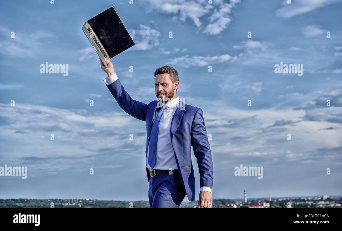 Looking for wifi network. Man raise up hand with laptop. Lack of coverage. Businessman with laptop wait while connect with internet. Connection problems. Businessman suit outdoors sky background. - Stock Image