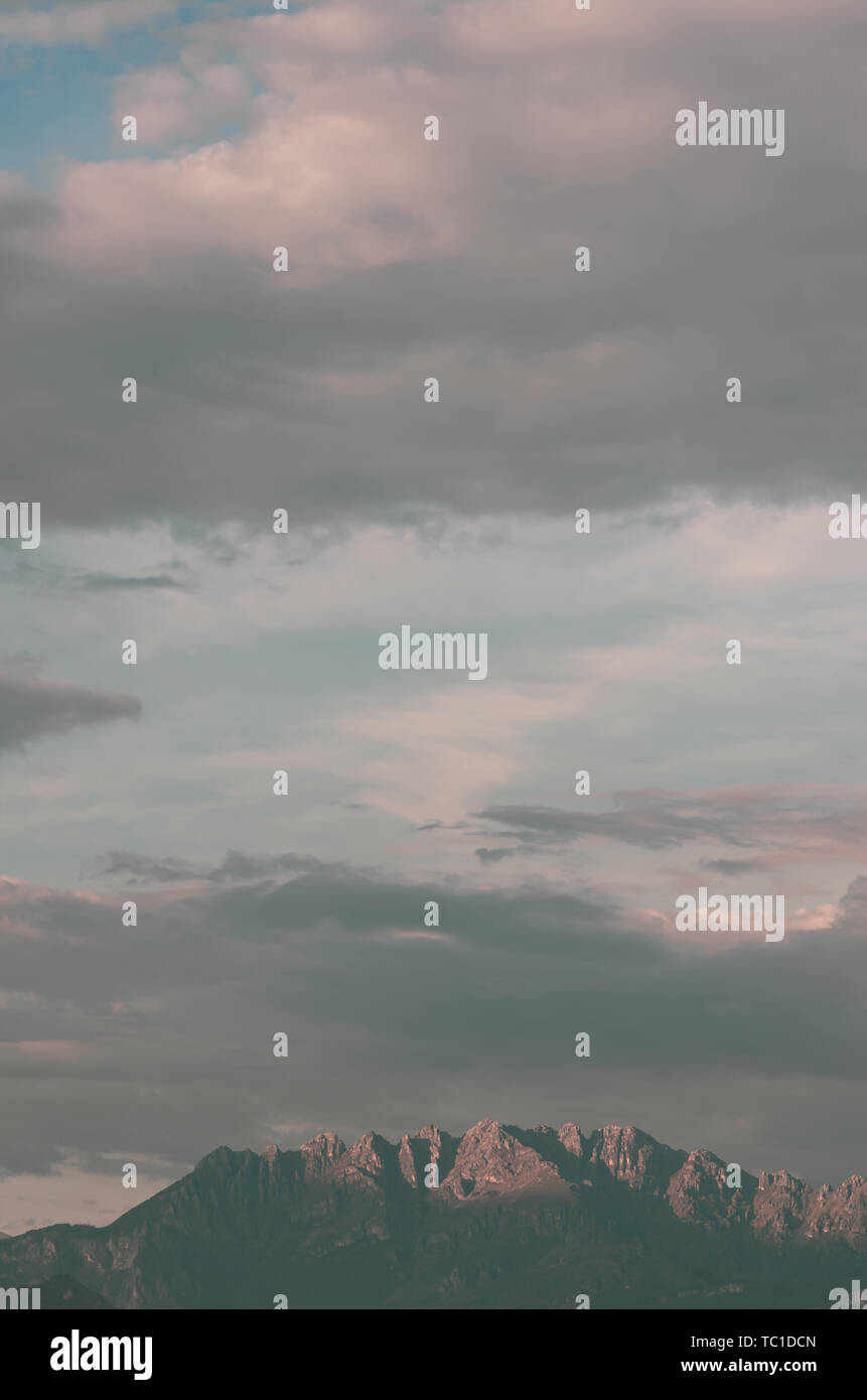 clouds formations over mountains and foothills top - spring weather - Stock Image