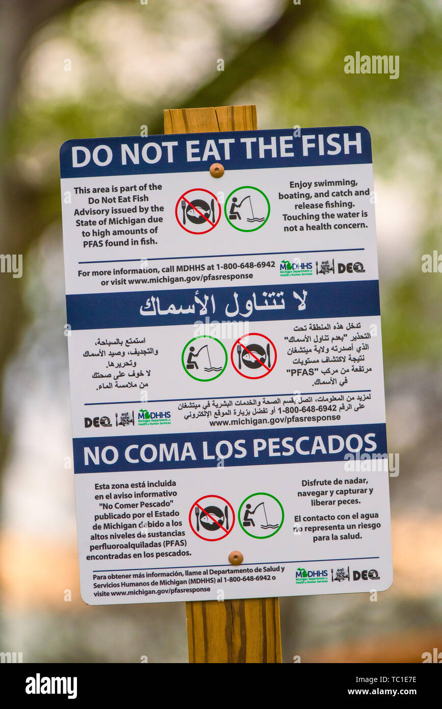 PFAS multilingual chemical contamination sign - 'Do Not Eat the Fish'  at Kent Lake, fed by the Huron River in Southeastern Michigan, USA. - Stock Image