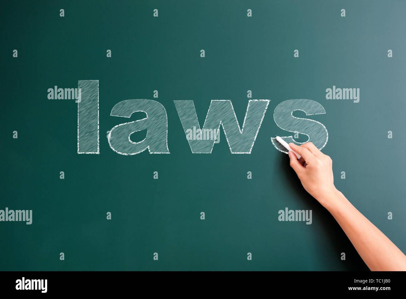laws written on blackboard - Stock Image