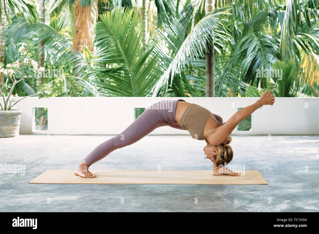 Woman Practicing Advanced Yoga On Organic Mat Series Of Yoga Poses Tropical Background Lifestyle Concept Stock Photo Alamy