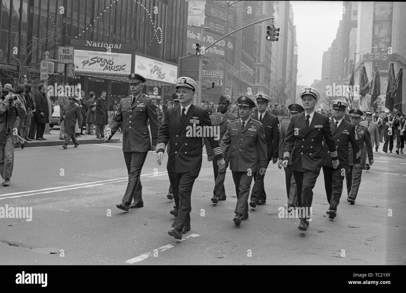 High ranking officers, wearing uniforms, march in the street