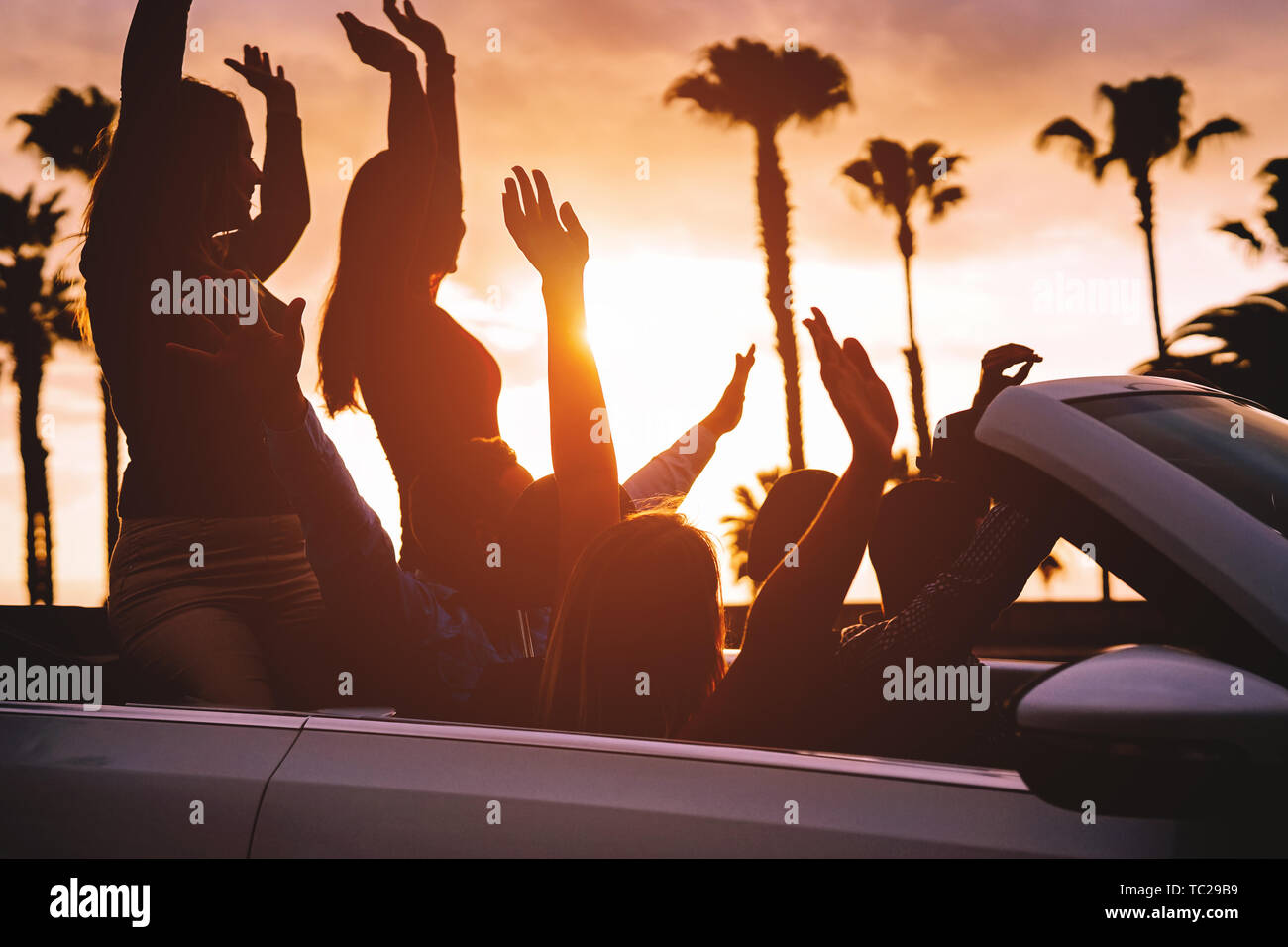 Group Of Friends Having Fun In Convertible Car During Road Trip At Sunset Young Travel People Driving A Cabriolet During Summer Holidays Stock Photo Alamy