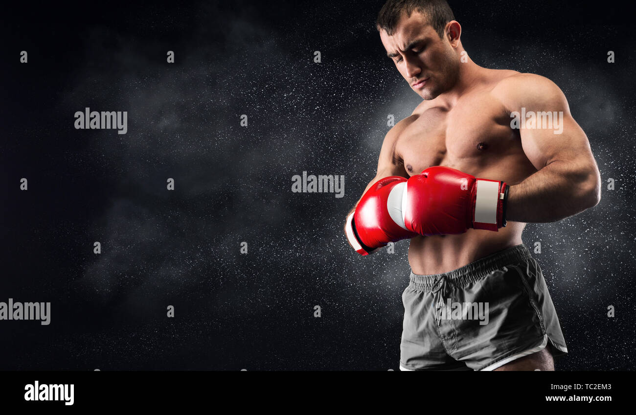 Young man boxer concentrating before decisive fight - Stock Image
