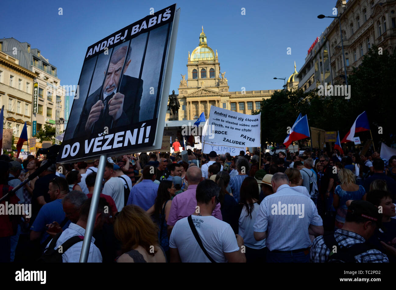 04 June 2019, Czechia, Prag: Demonstrators hold signs in protest against Babis, the head of government. At one of the largest demonstrations since the democratic change of 1989 tens of thousands of demonstrators filled the central Wenceslas Square in Prague on Tuesday evening (04.06.2019). They demanded the resignation of the politician. Babis is accused of having benefited unlawfully from EU subsidies for years as an entrepreneur. Photo: Michael Heitmann/dpa - Stock Image